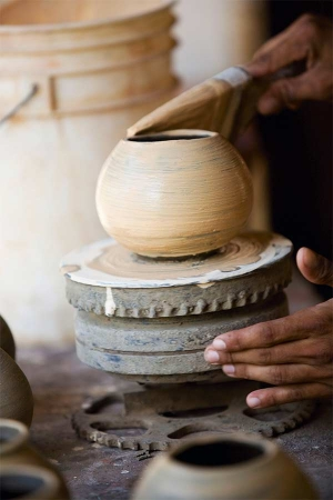 A potter works the clay on thewheel in Guaitil, Guanacaste. Close to Santa Cruz in Costa Rica