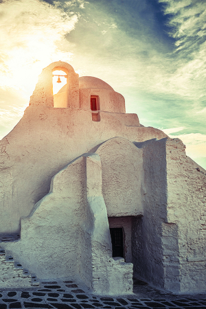 Sunrise over one of Mykonos Town's many churches