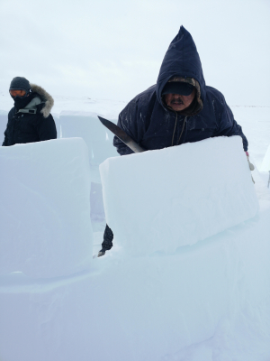 Peter Boy Itukalla builds an igloo in white-out conditions in Nunavik, Canada
