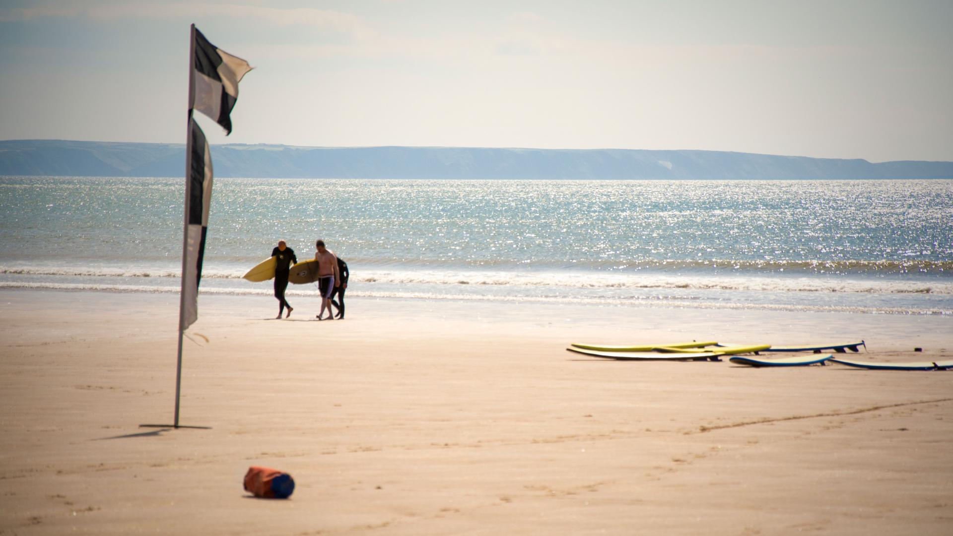 Surfing at Croyde Beach, Devon