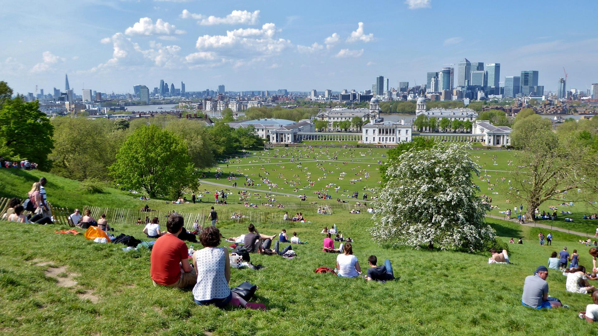 View across Greenwich Park taking in The Shard, the City of London, River Thames, National Maritime Museum, Queen's House, the Old Royal Naval College, and Canary Wharf. Greenwich Park, Greenwich, London
