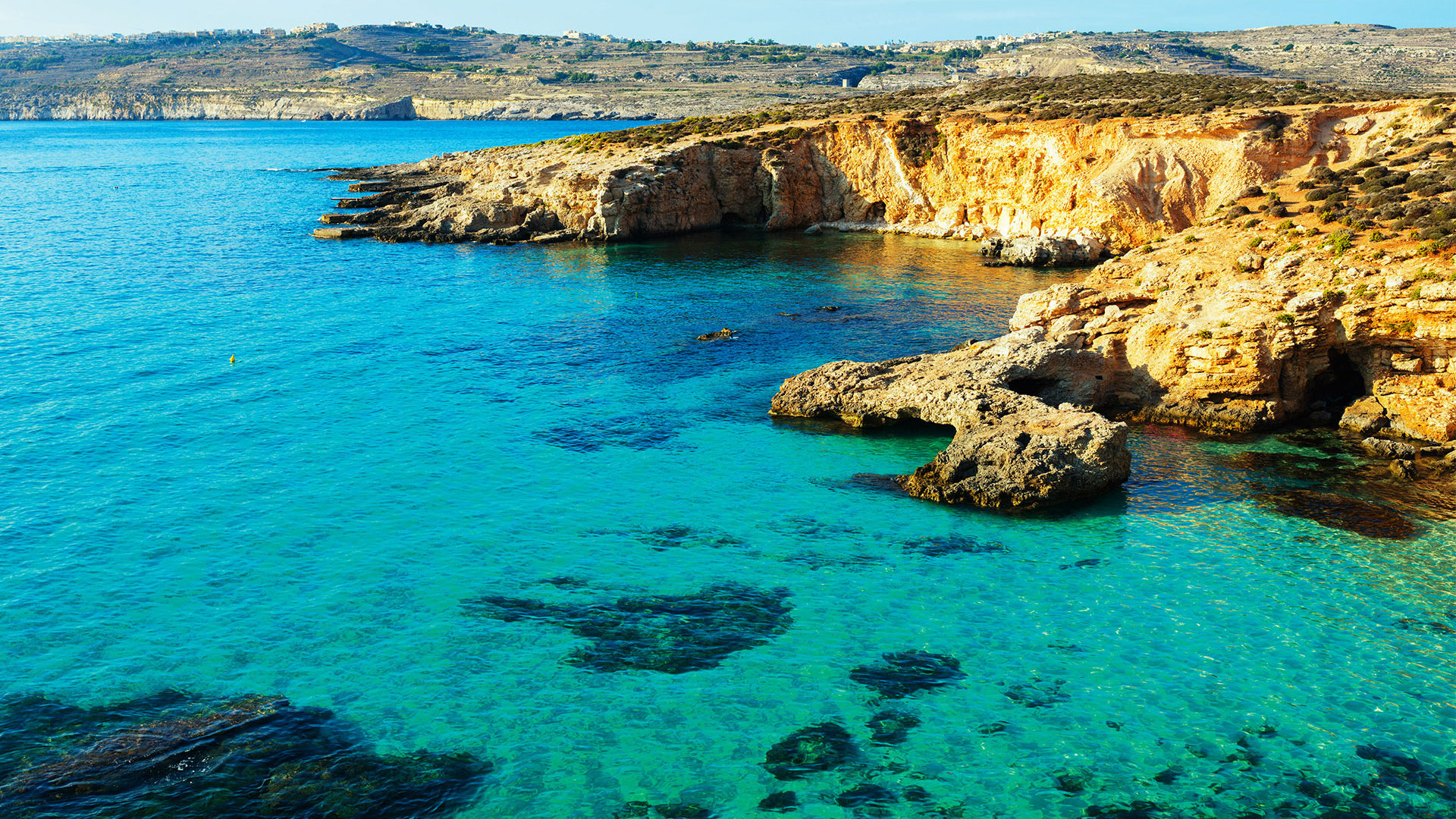 Photograph of Comino Island's gorgeous blue lagoon