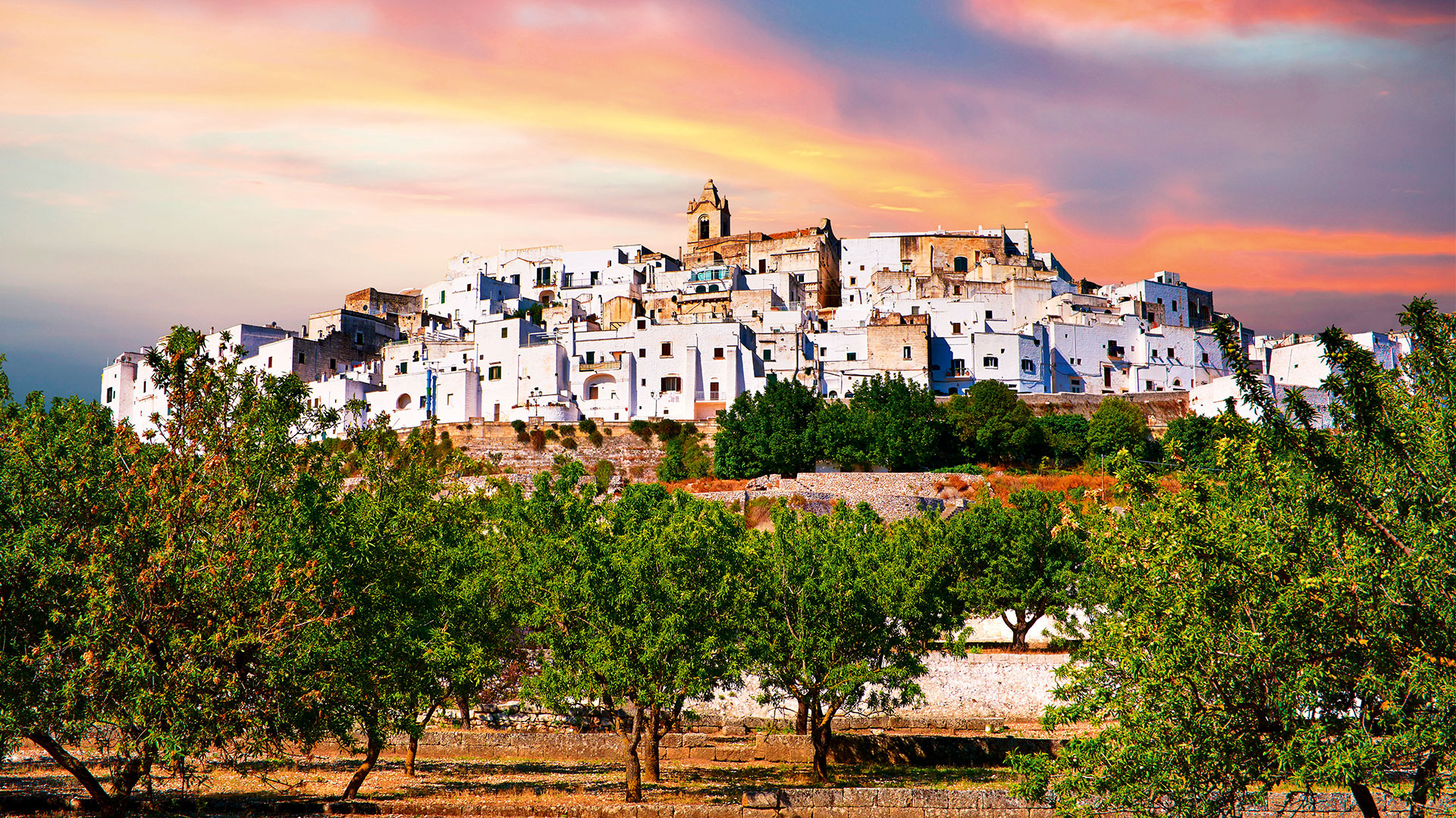 Medieval fortified town of Ostuni at sunset, Puglia, Italy