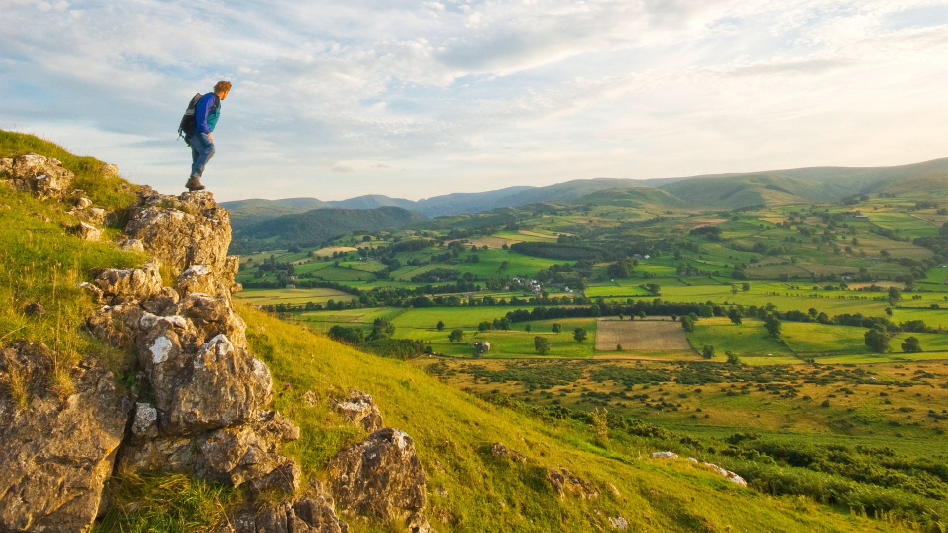Hiker standing at the top of knipe scar