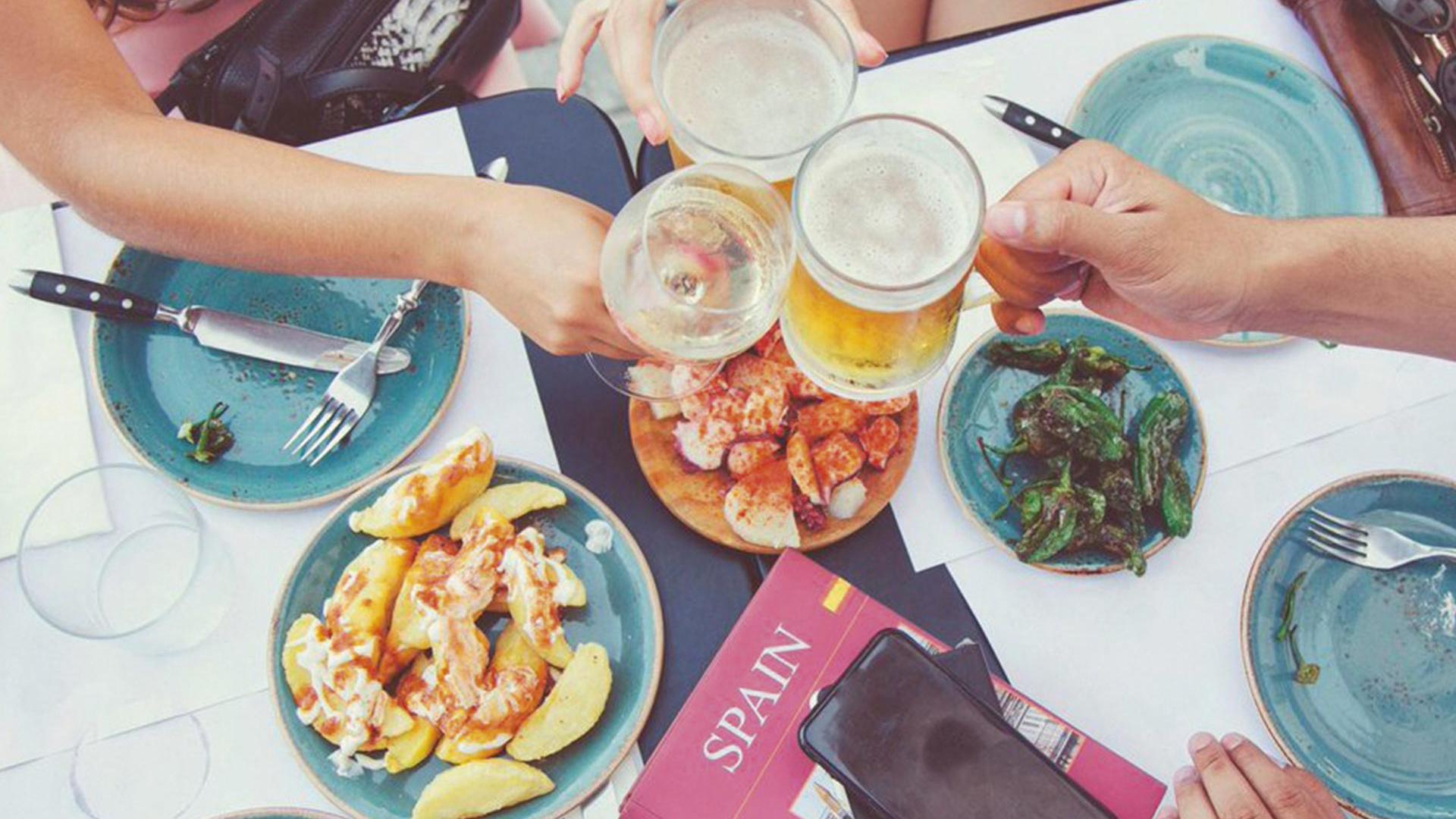 Sharing tapas at world tapas day in Spain