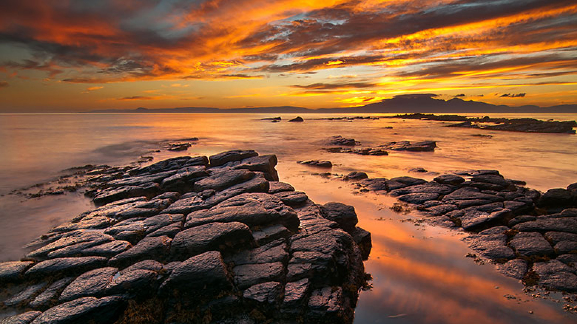 Fiery-Sky-over-the-Isle-of-Arran,-Firth-of-Clyde,-Scotland-by-Peter-Ribbeck-(Take-a-view,-2013)
