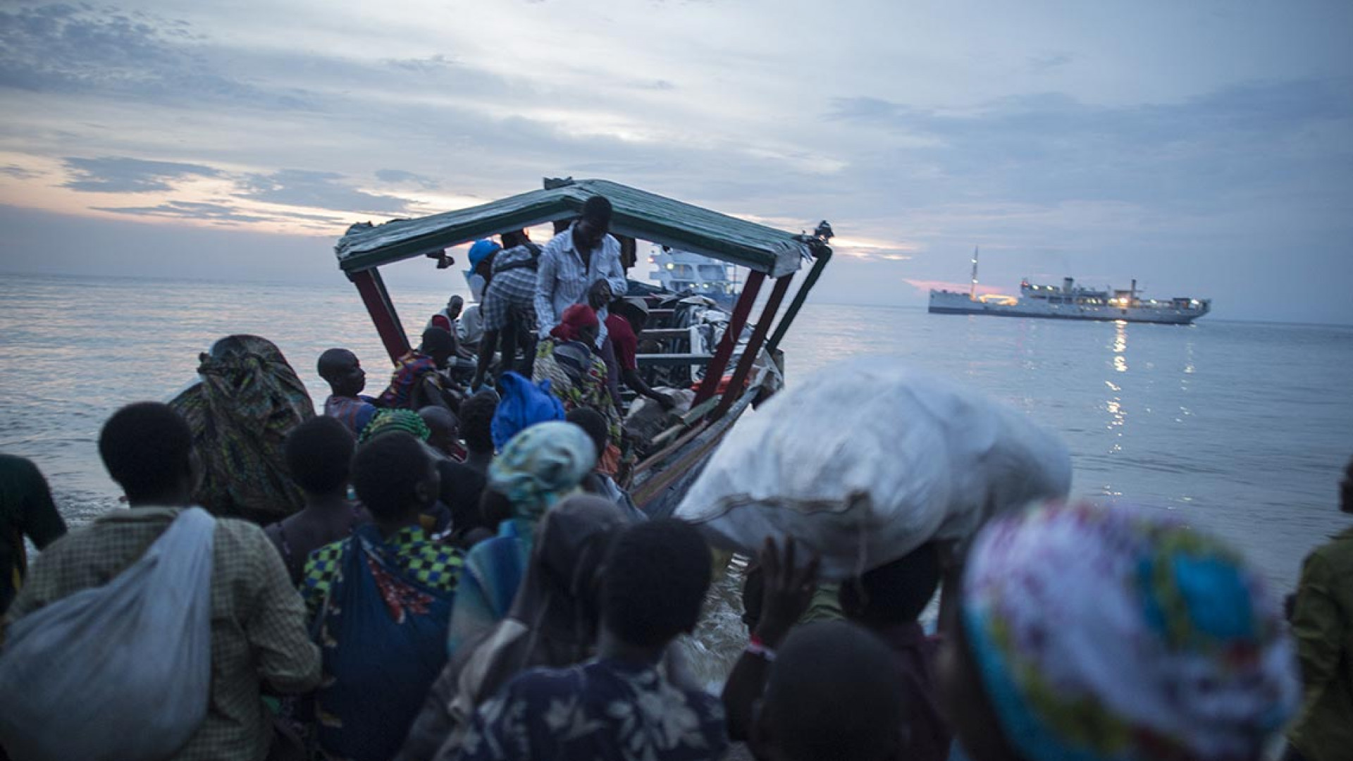 Refugees risking their lives travelling over seas in dangerously overcrowded boats