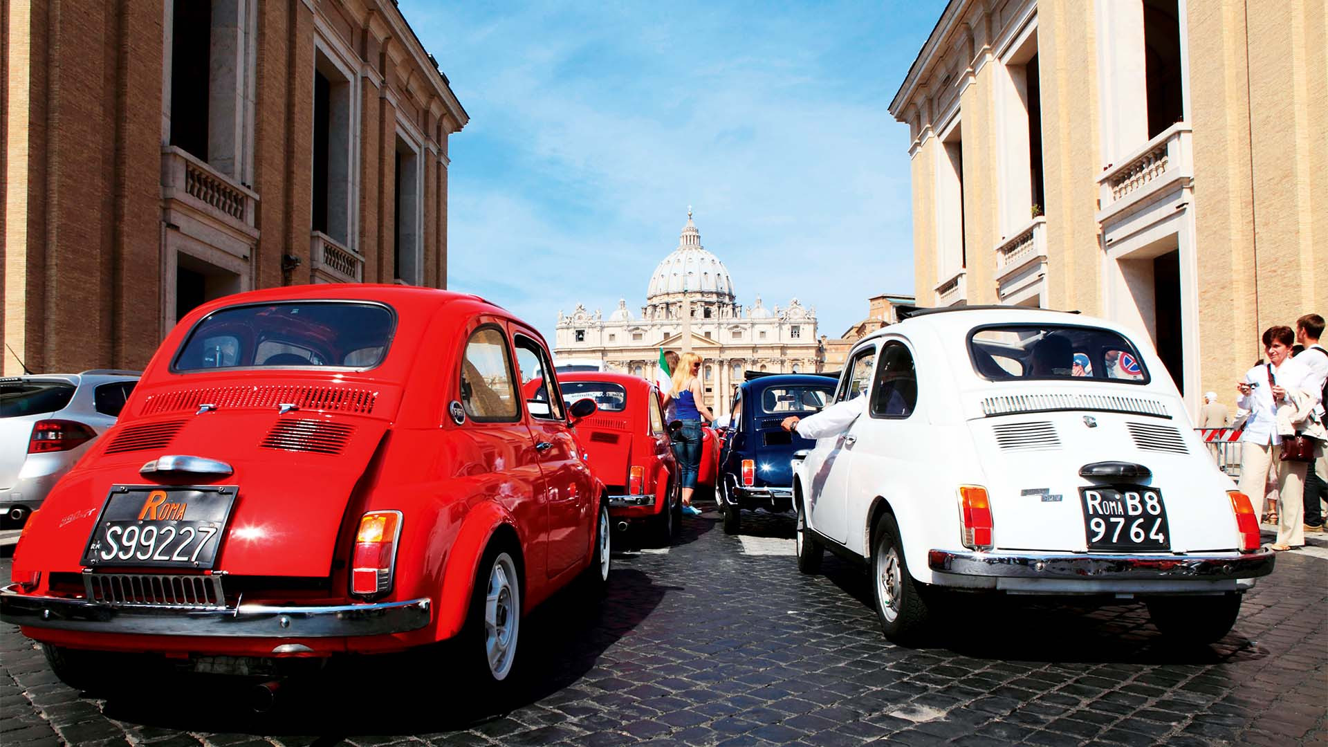 A line of Fiat 500 cars in Rome, Italy
