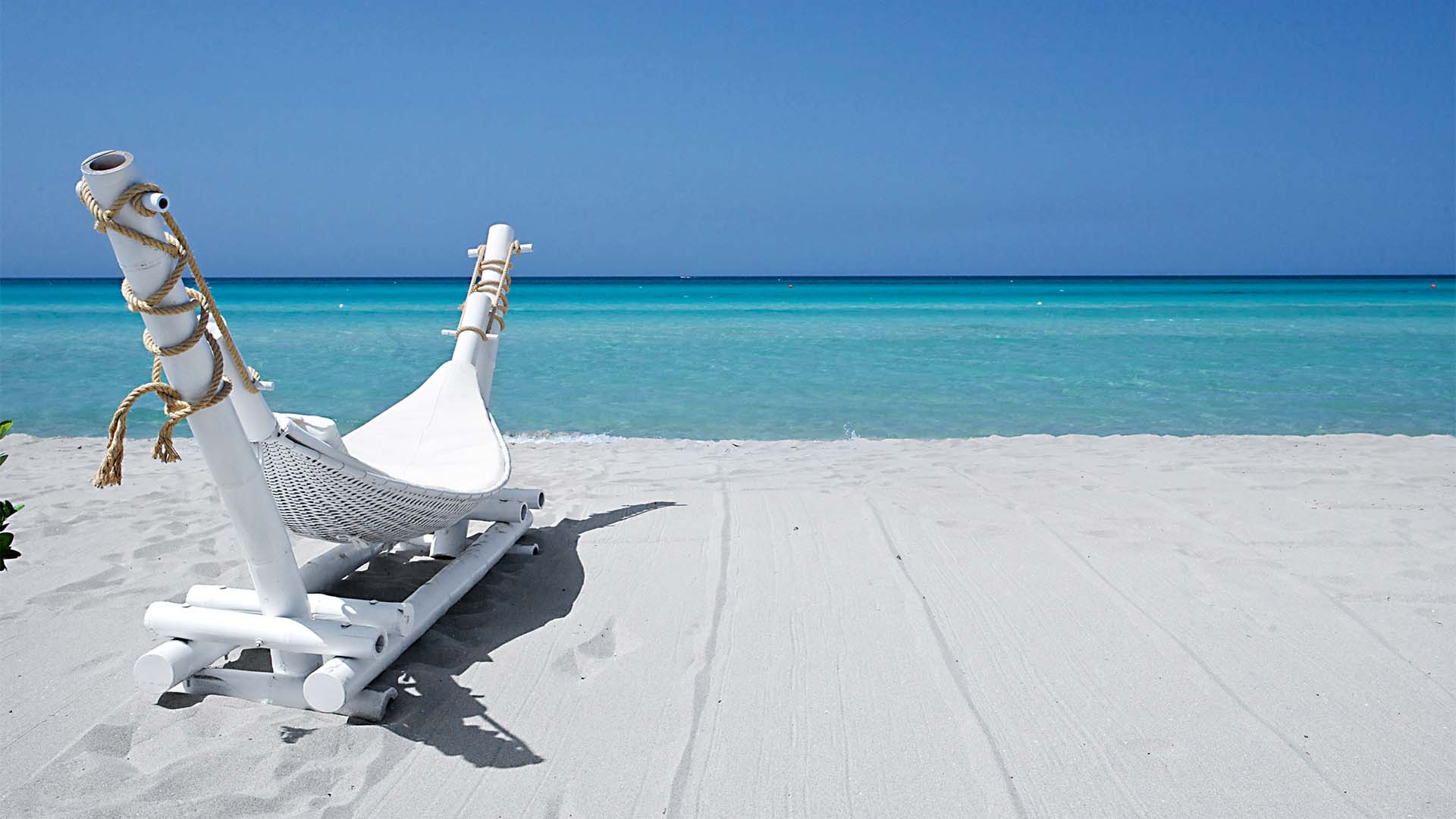 Lounger on the beach, Puglia, Italy