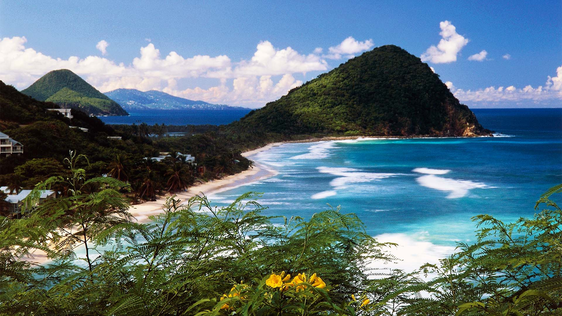 A clifftop view and beach in Tortola