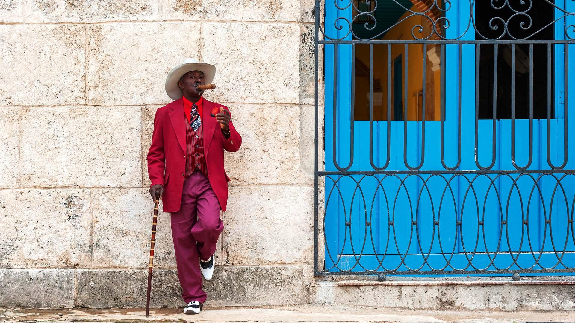 A man smoking a cigar on the street in Cuba