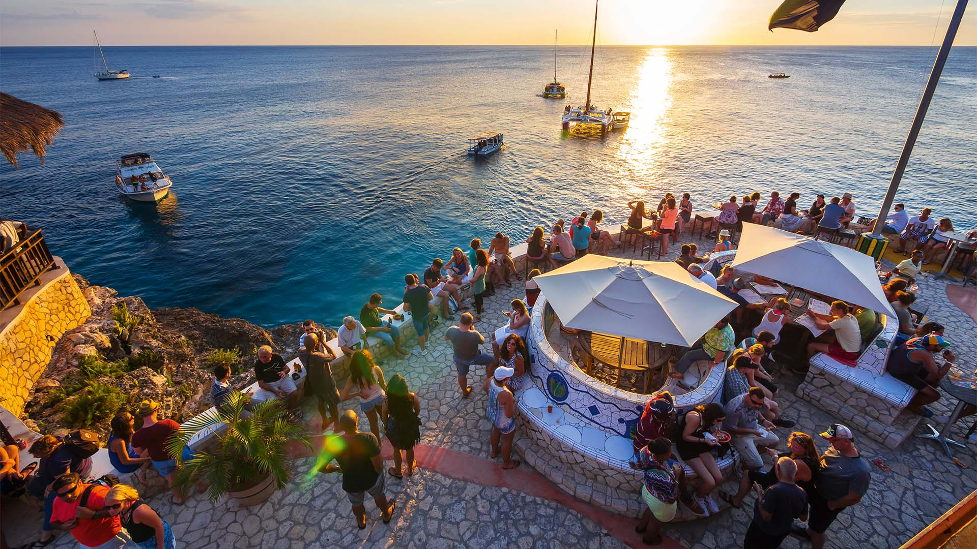 View of the terrace at Rick's Café with the sunset over the Caribbean sea