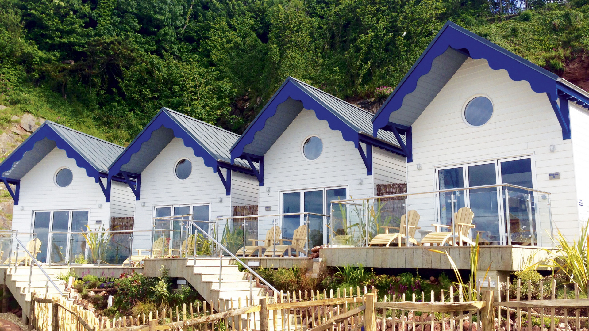 Blue and white beach huts at the Cary Arms