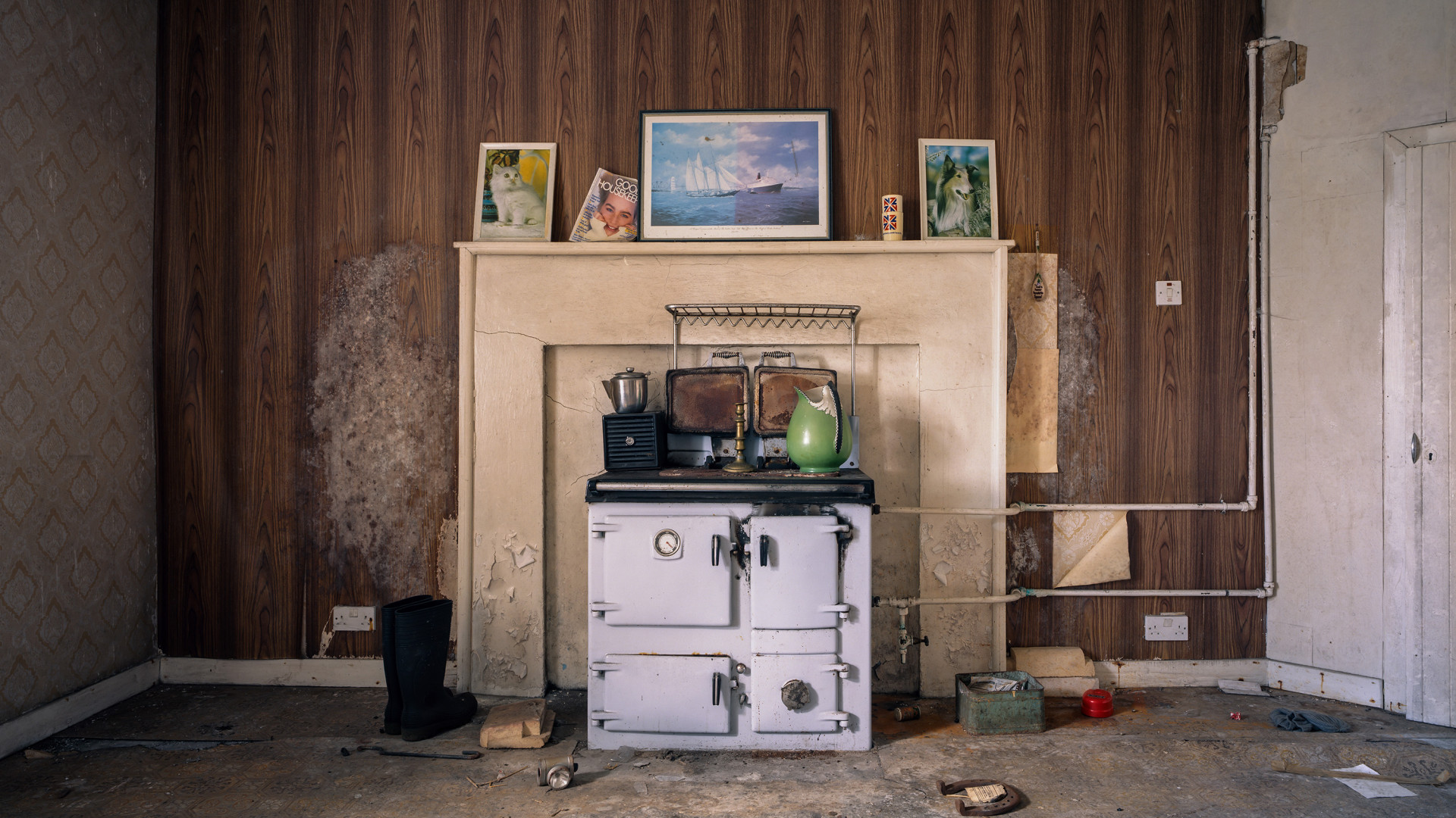 Stove and decorations in abandoned Hebridean home