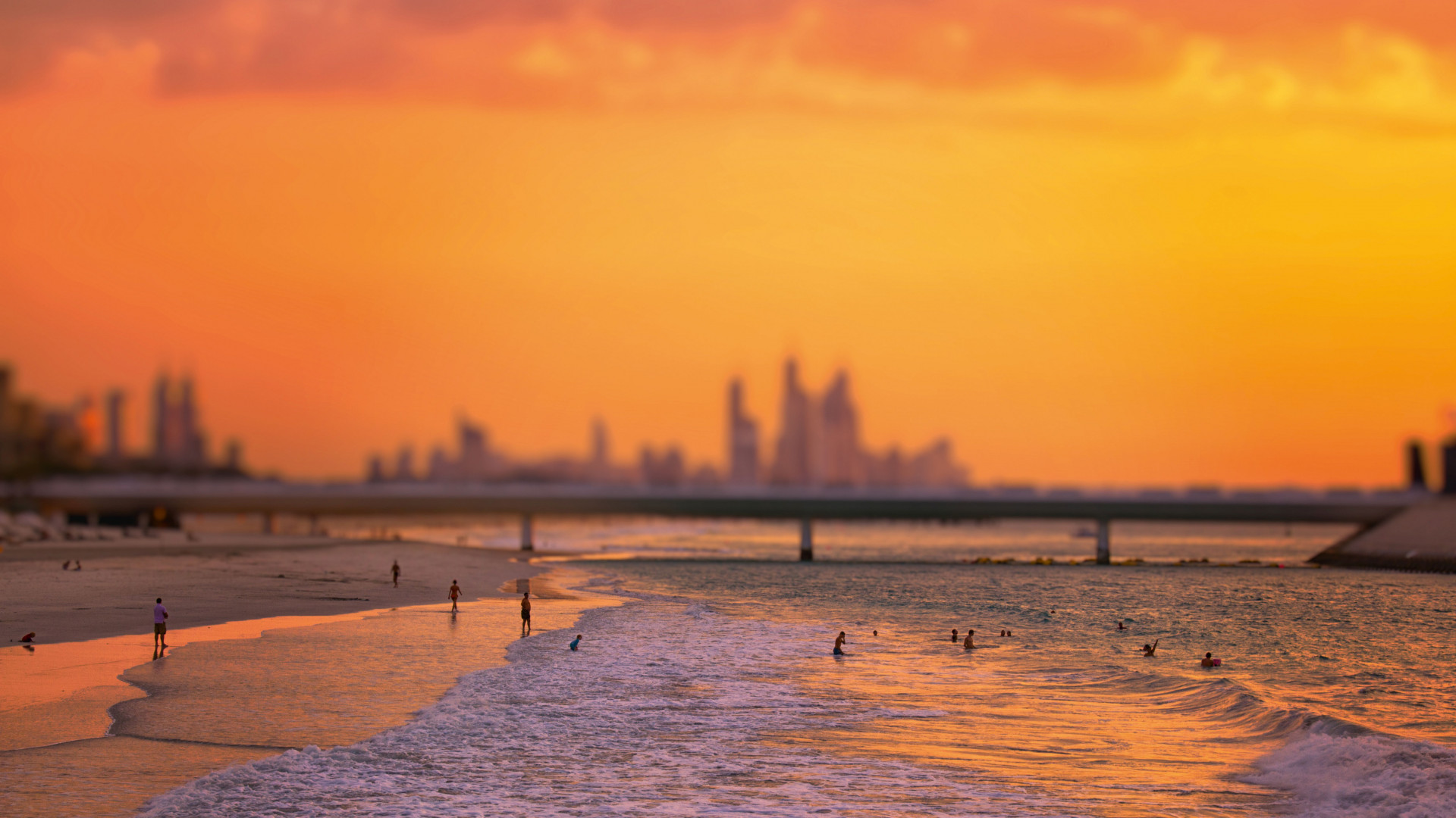 Dubai beach at sunset with skyline in background