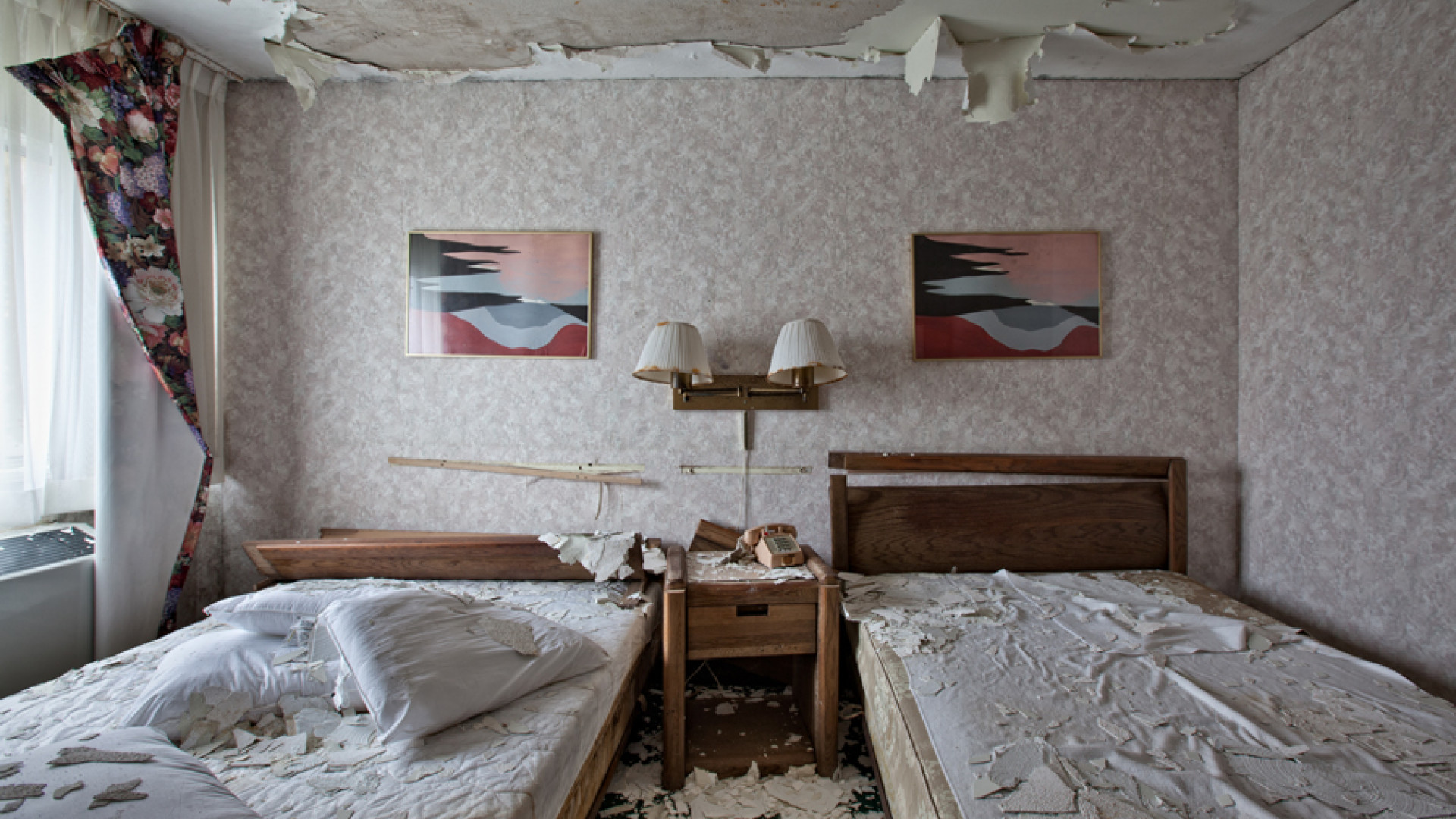 Two beds in a vandalised room in Niagara Falls