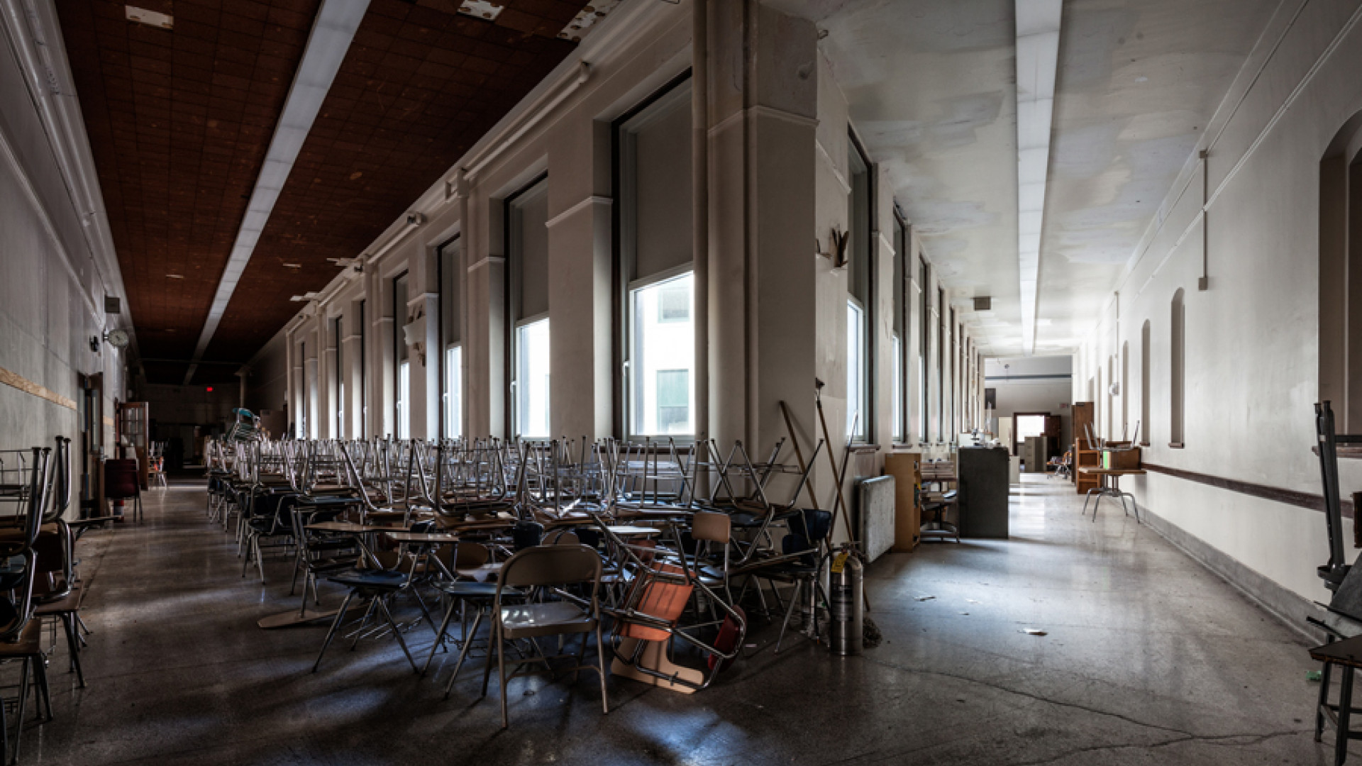 Chairs stacked inside the abandoned Schenley High School, Pittsburgh