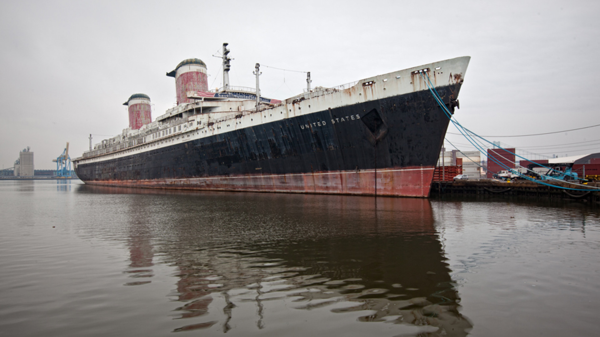 Full exterior shot of the SS United States in harbour