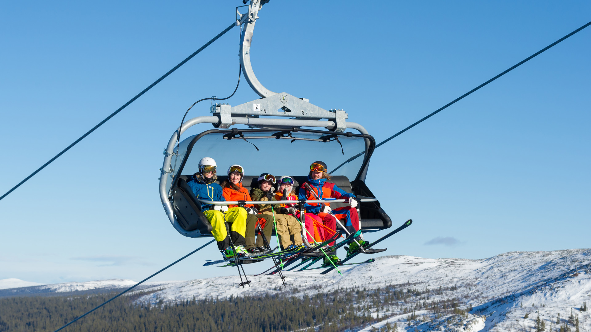 Family on a ski lift in Sweden