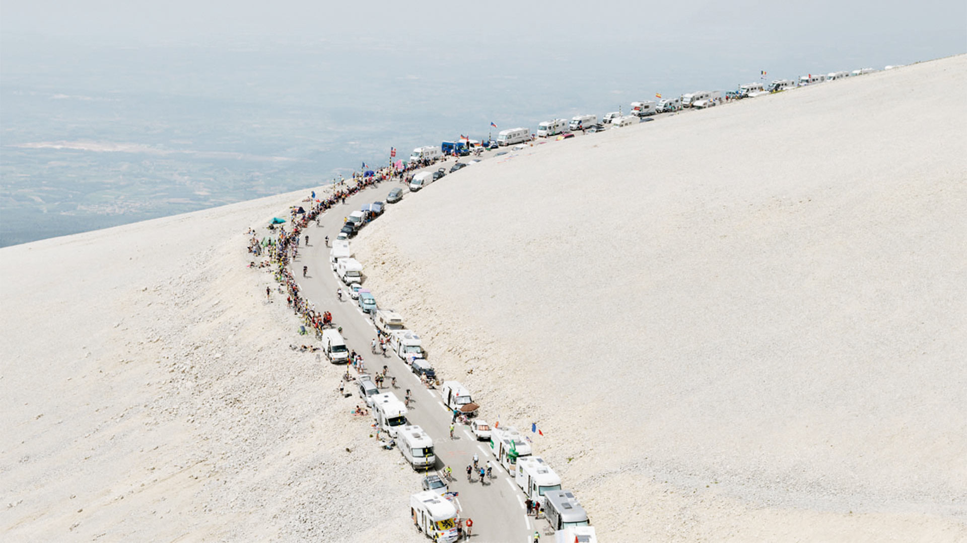 French mountain pass with cars and cycle race