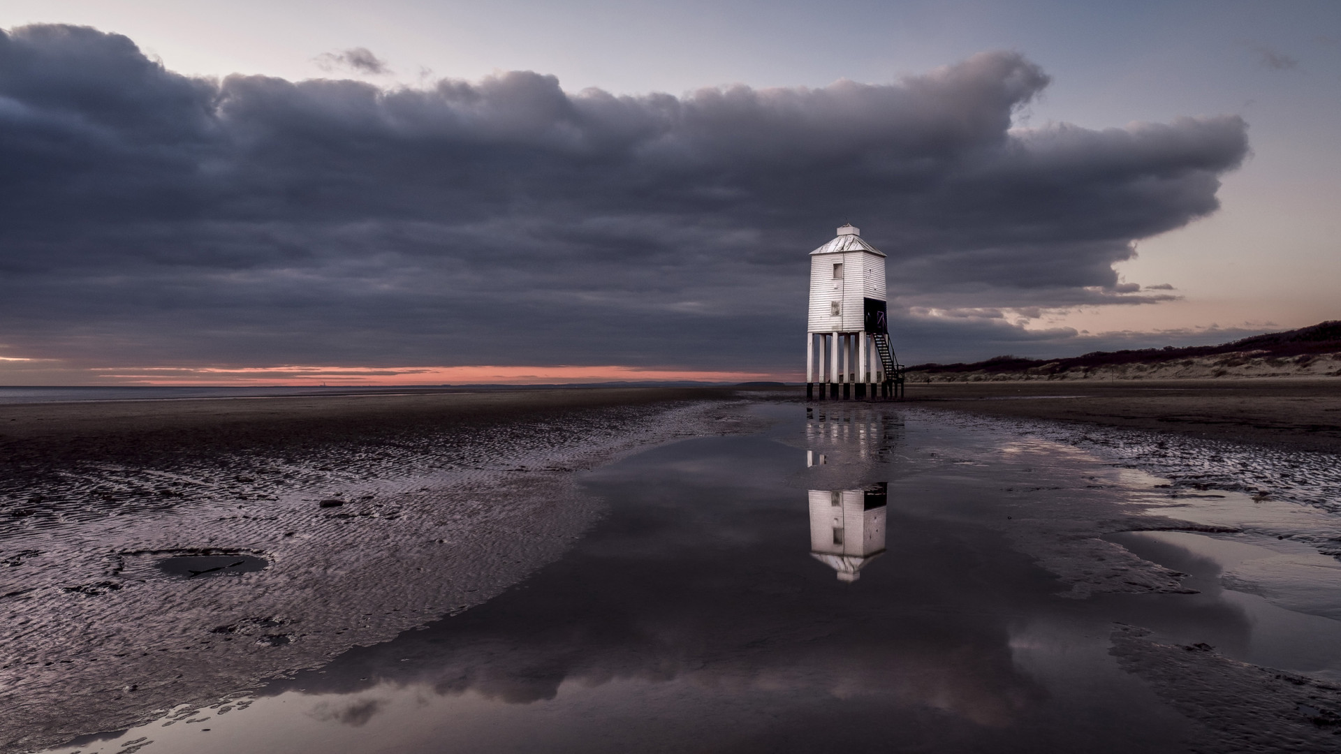 Sunset next to a wooden lighthouse in Somerset