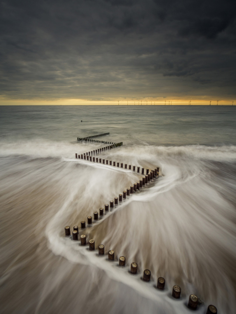 Slow shutter speed shot of a wave drawing back at Caister-on-sea