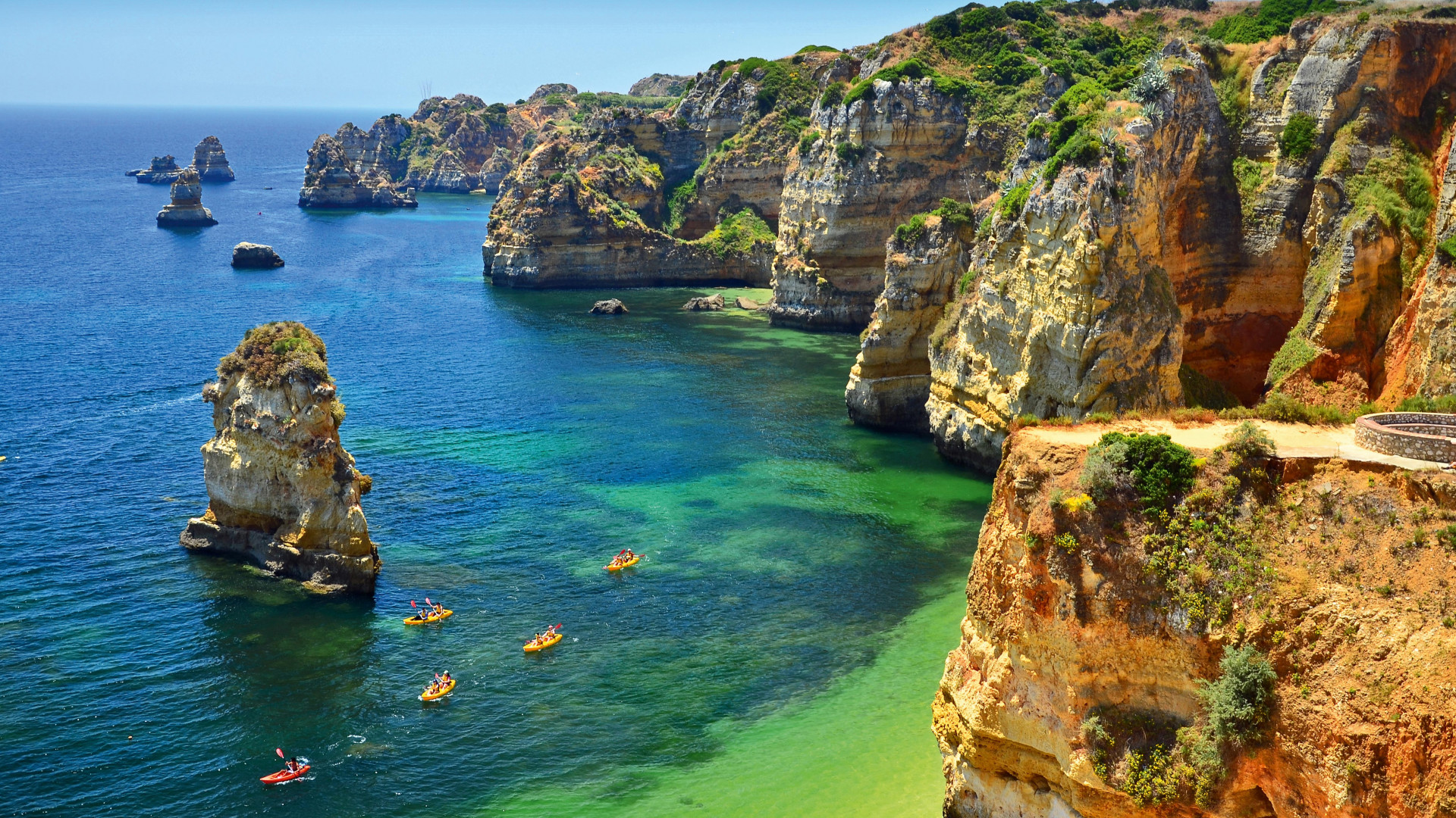 Kayaks and coastline in the Algarve