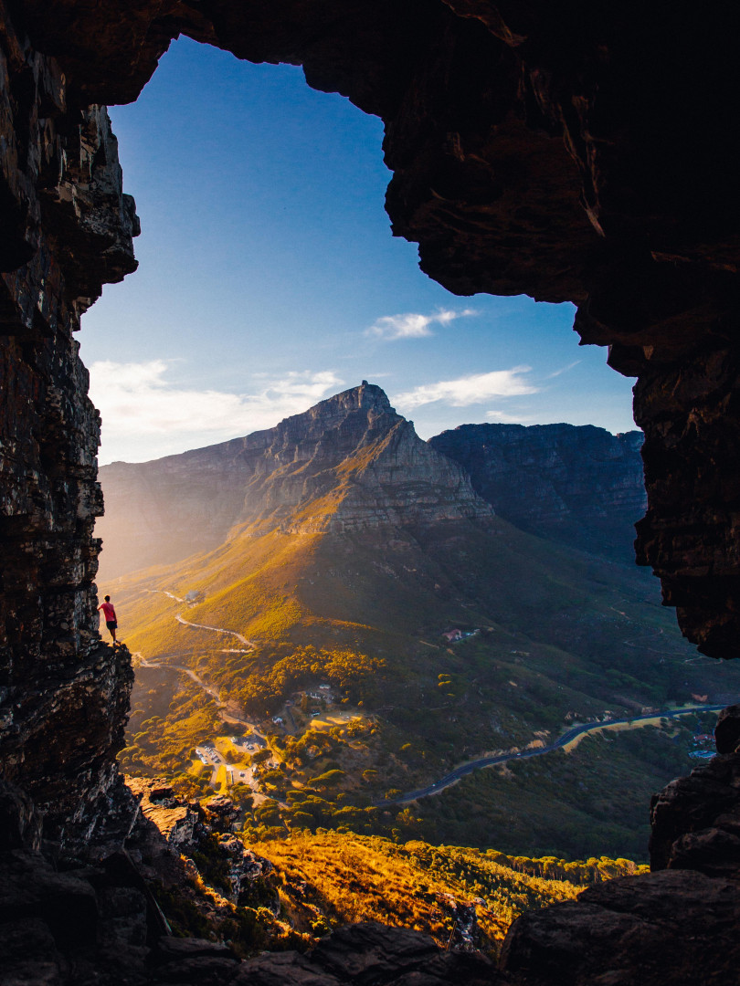 Hiker on the edge of Lion's Head near Cape Town in South Africa