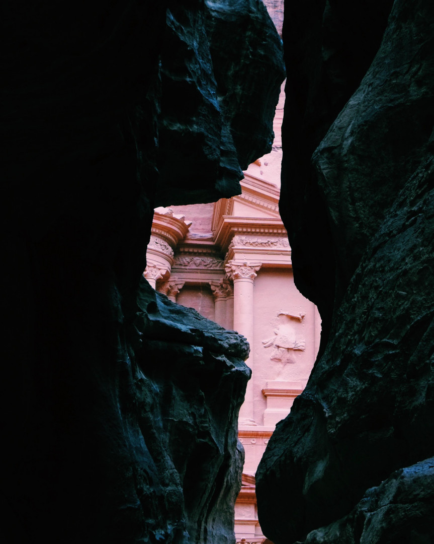 The Treasury in Petra through the narrow 'Siq' path through the rocks