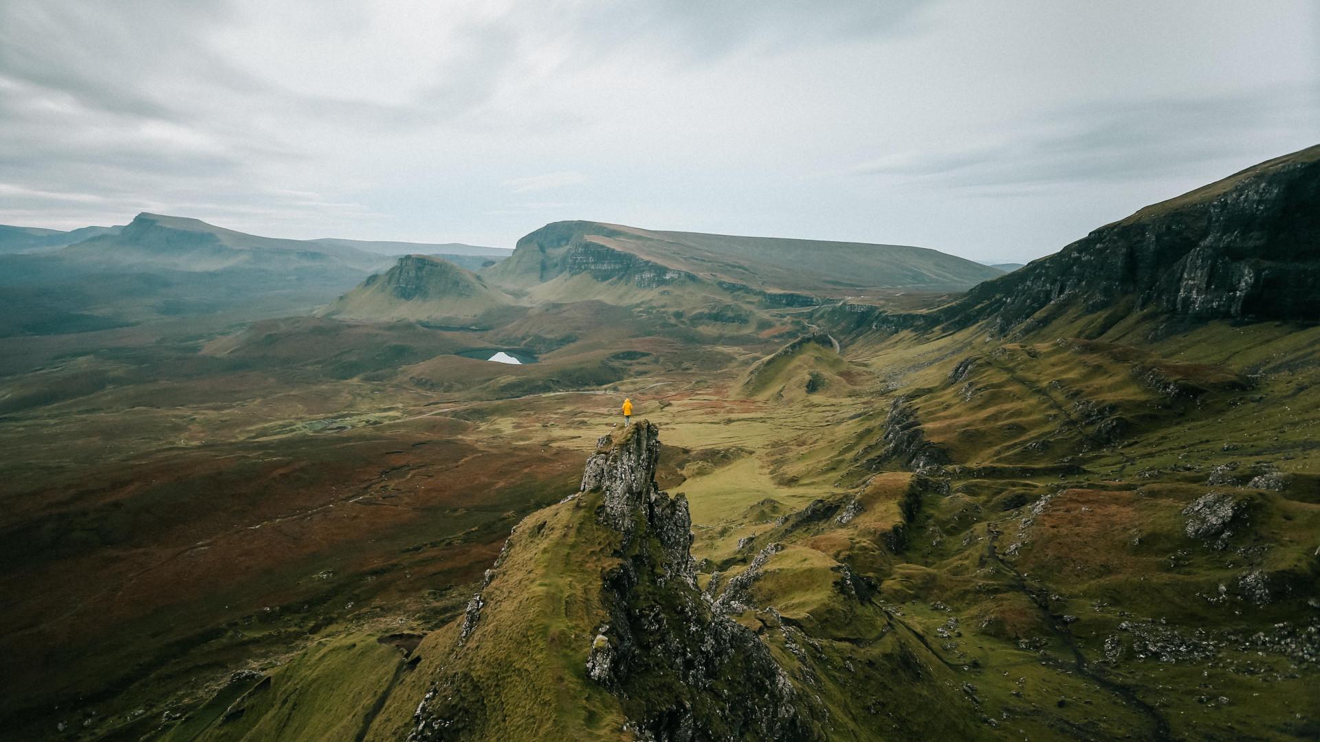 Hiker stood on a stack on the Isle of Skye, UK