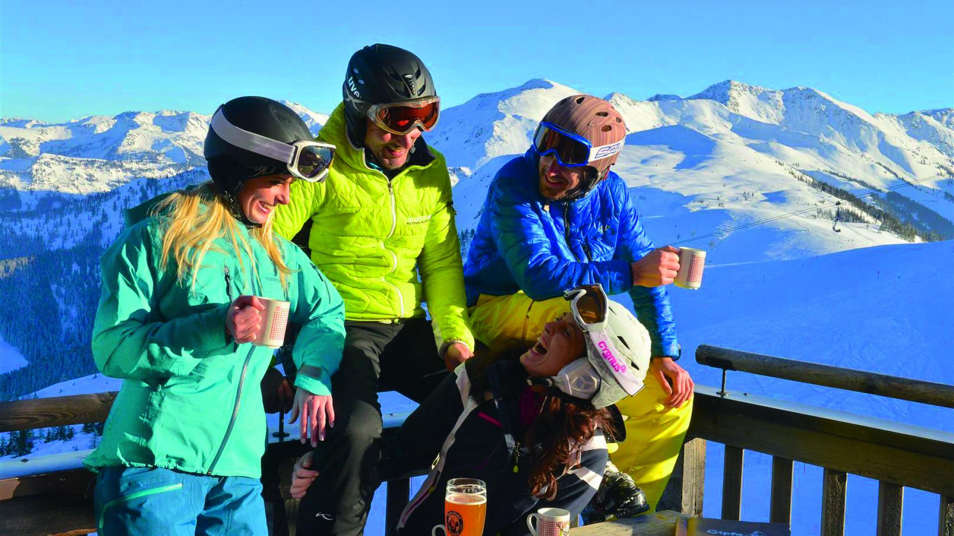 People enjoying an alpine bar in Austria