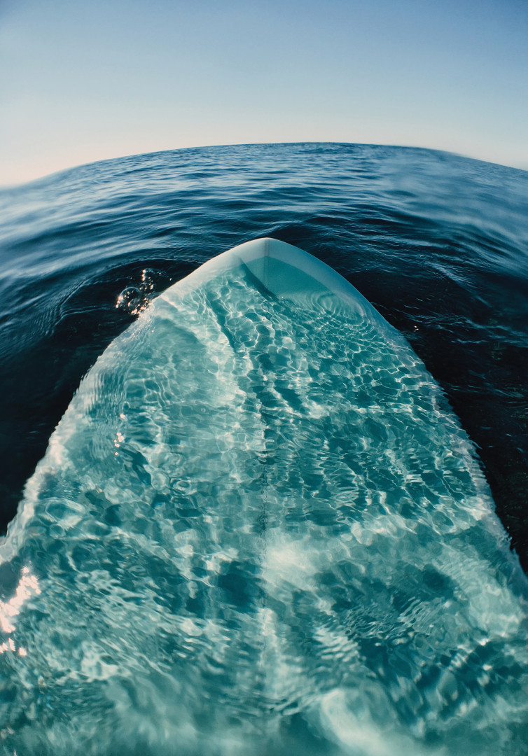 A surfboard submerged in the ocean