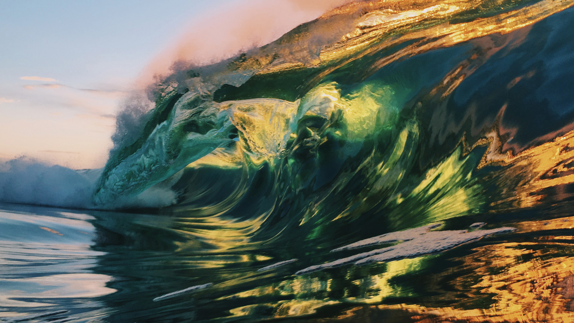 Light glowing through a breaking wave in the ocean