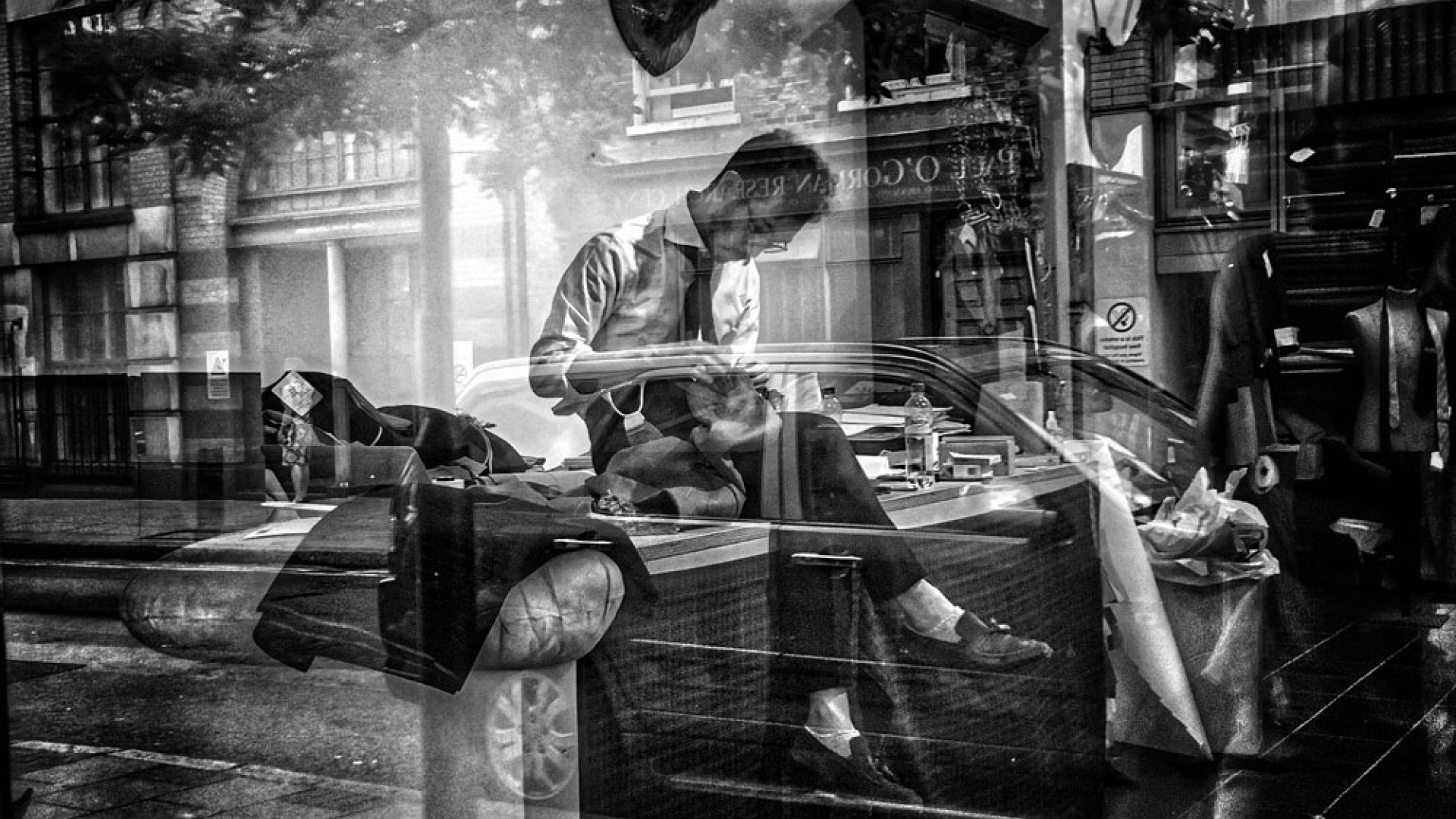 Reflections in the window of a tailor shop on Lambs Conduit Street