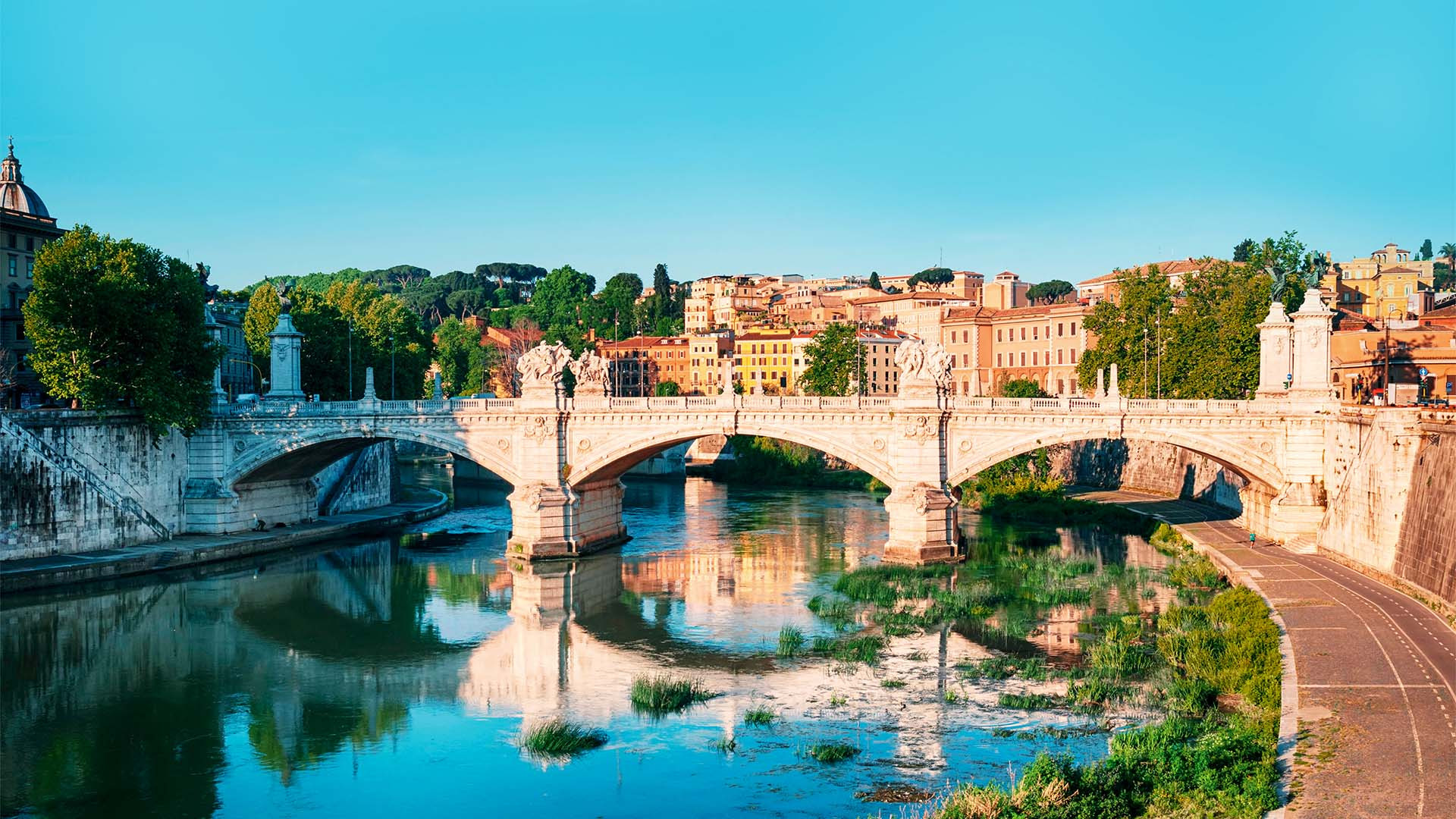 St. Angelo Bridge (Ponte Sant Angelo) and the Trastevere district in Rome with River Tiber