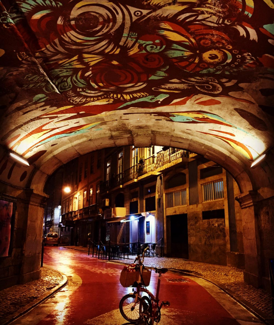 Brompton bike under street art archway