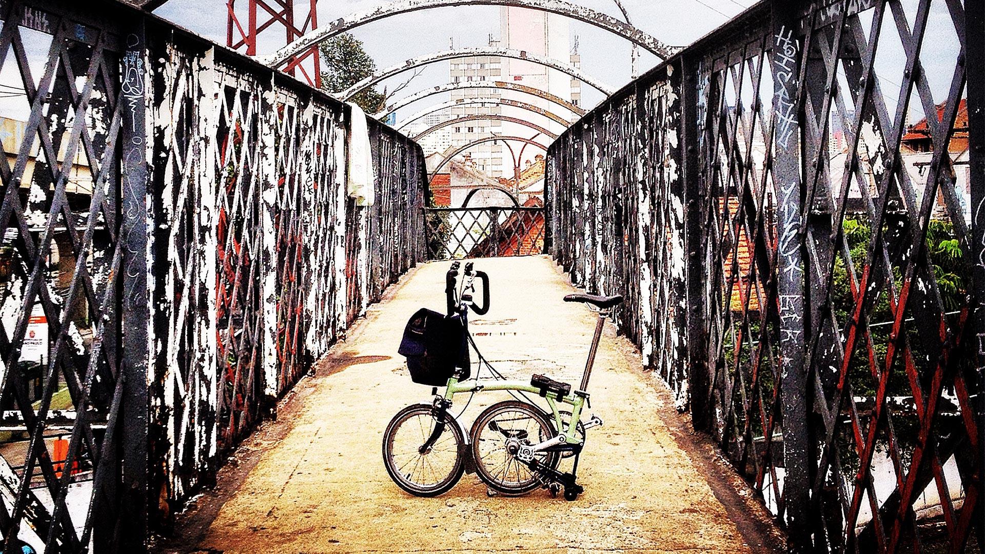 A brompton bike on a bridge in Sao Paolo, Brazil