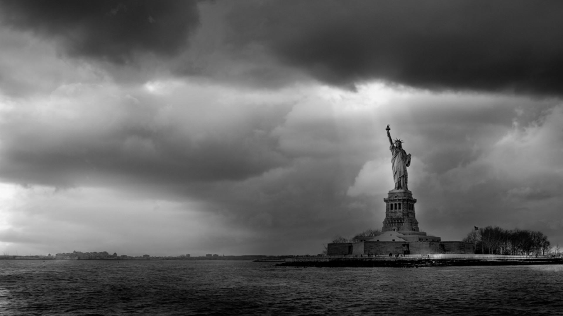 Statue of Liberty in storm clouds, New York, black and white, by Serge Ramelli