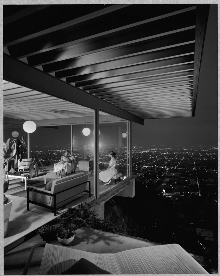 View through a glasshouse over the hills of LA, by Julius Shulman