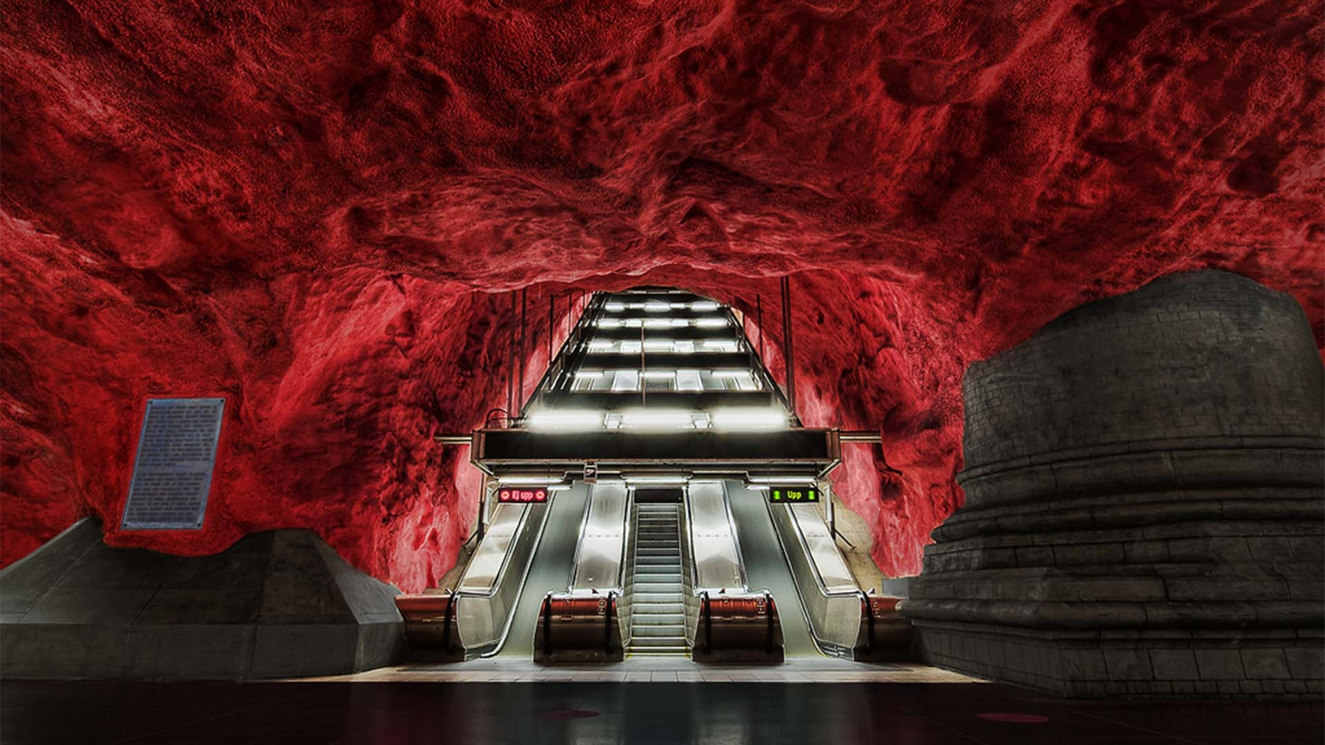Red painted mural at Solna Centrum metro station, Stockholm