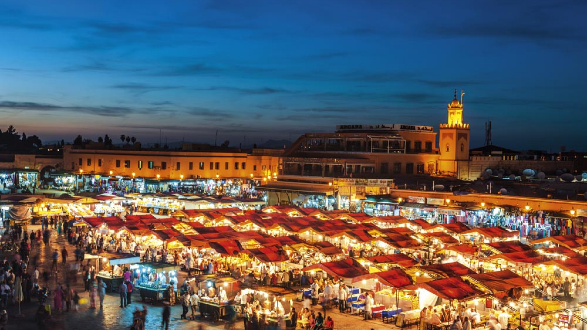 Evening at Djemaa El Fna Square with Koutoubia Mosque, Marrakech, Morocco
