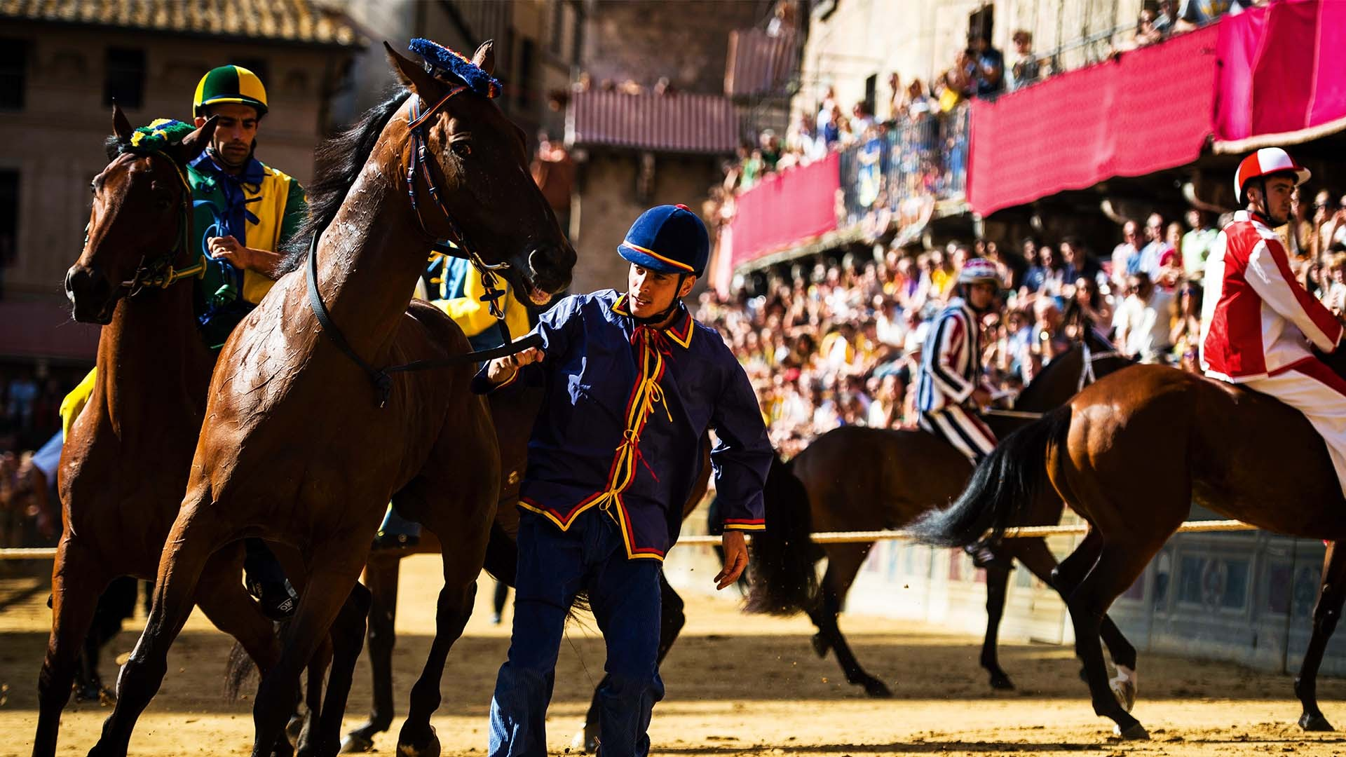 Riders in Il Palio horse race, Siena, Italy