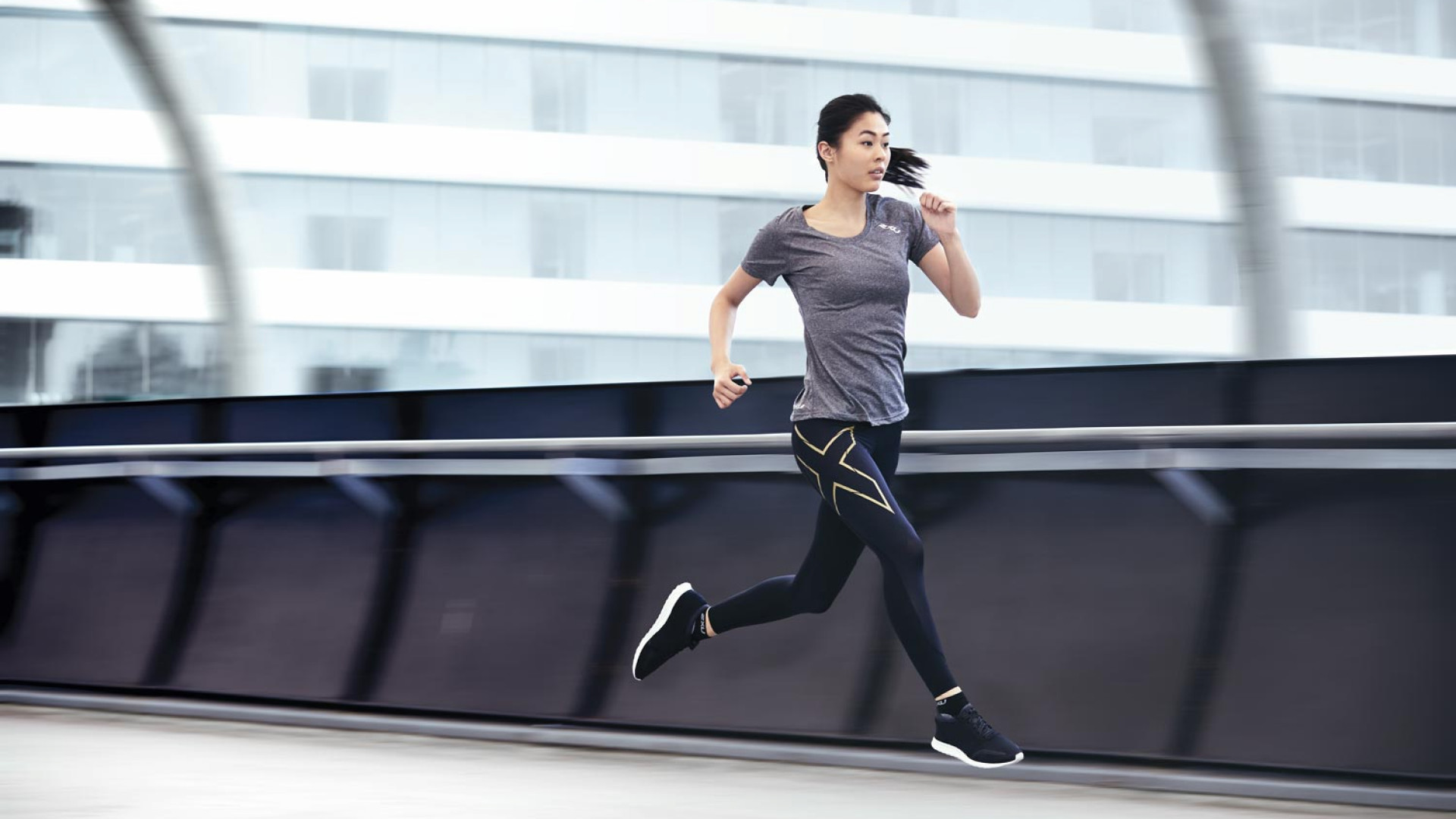 Female runner in 2XU compression garments