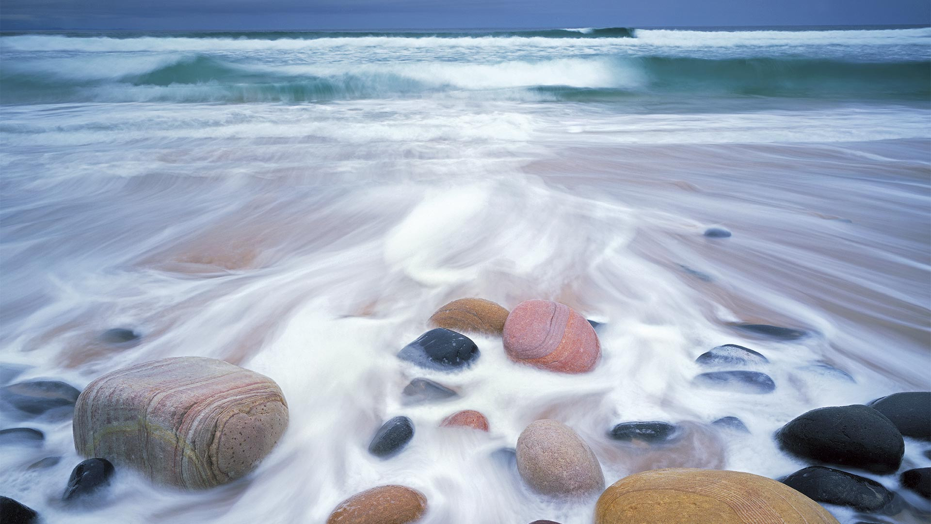 Boulders in the surf at Rackwick Bay, Orkney Islands, Scotland