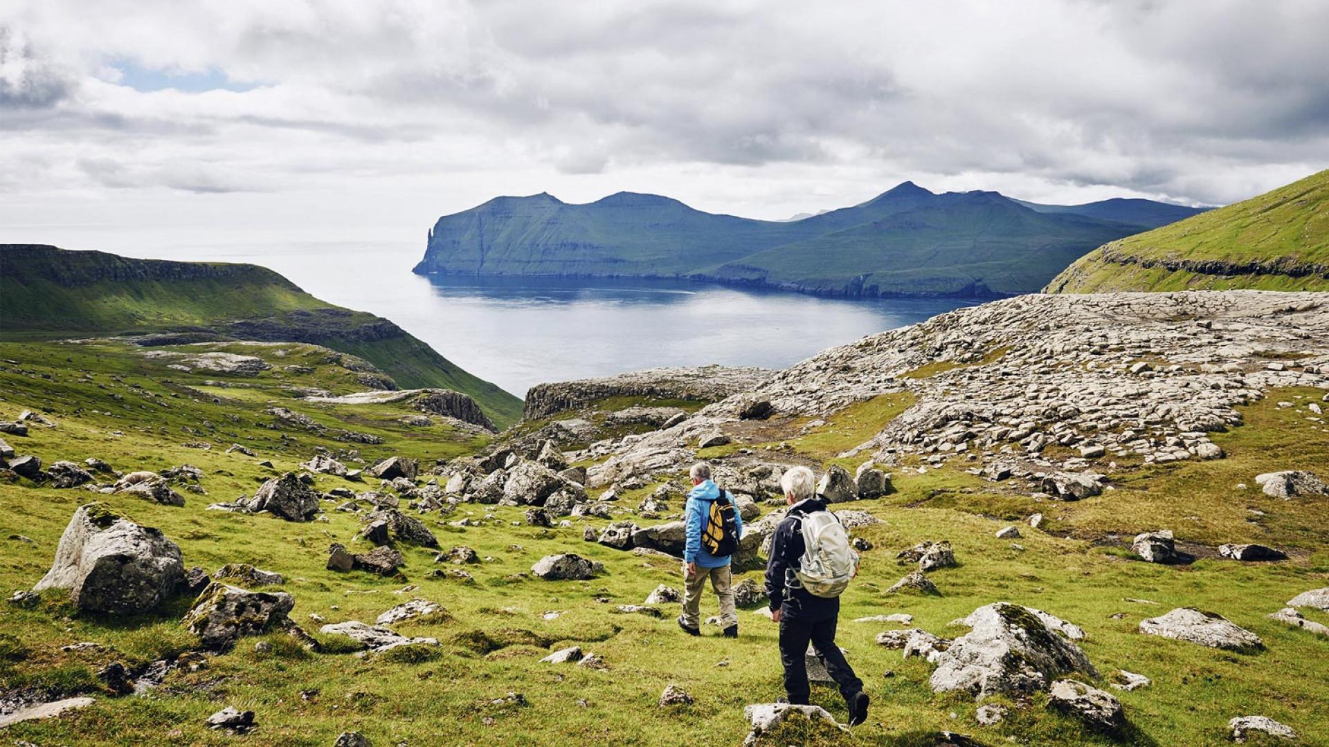 Hiking along the coast in the Faroe Islands