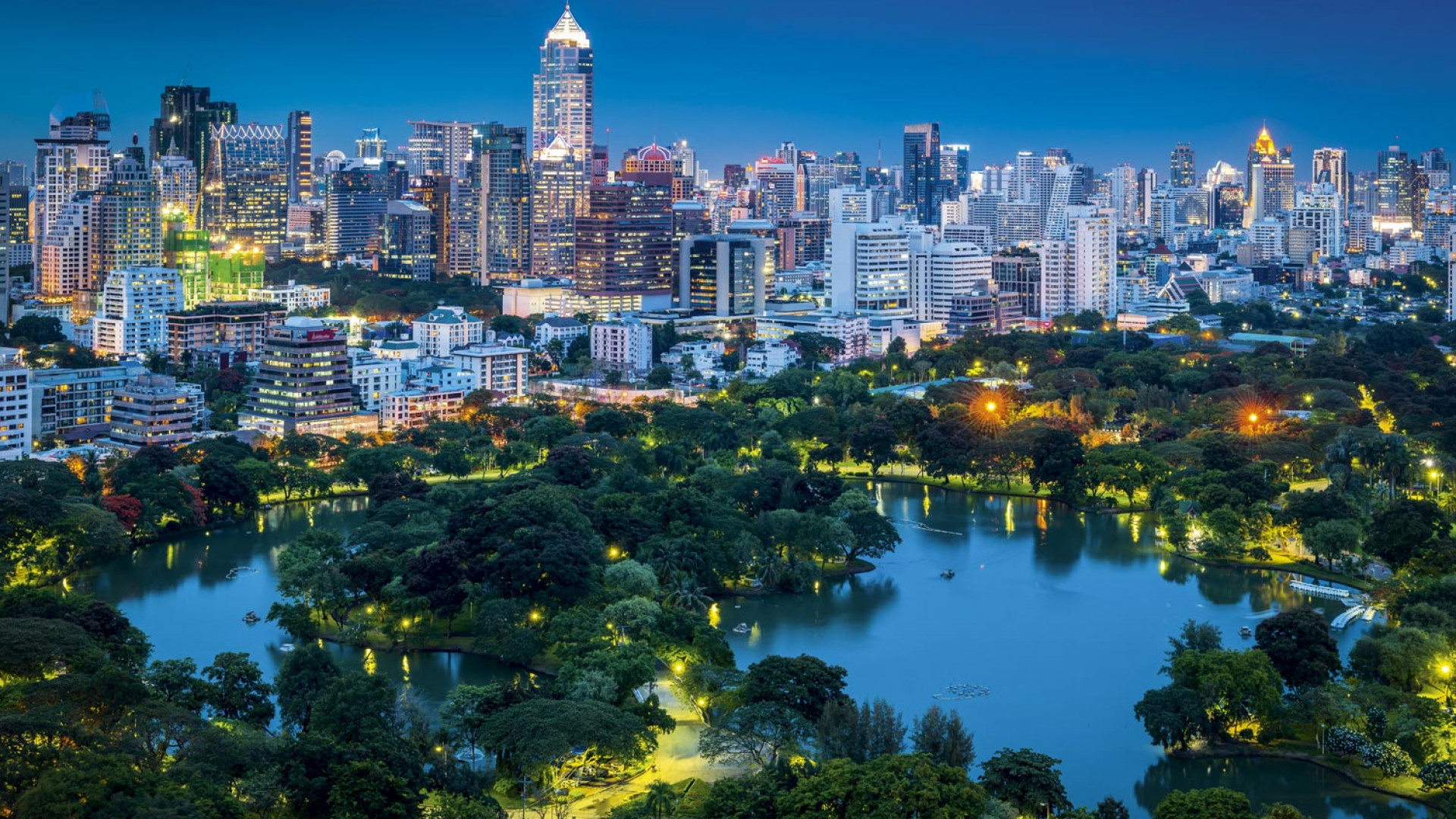 Lumphini Park and the skyline of Bangkok , Thailand