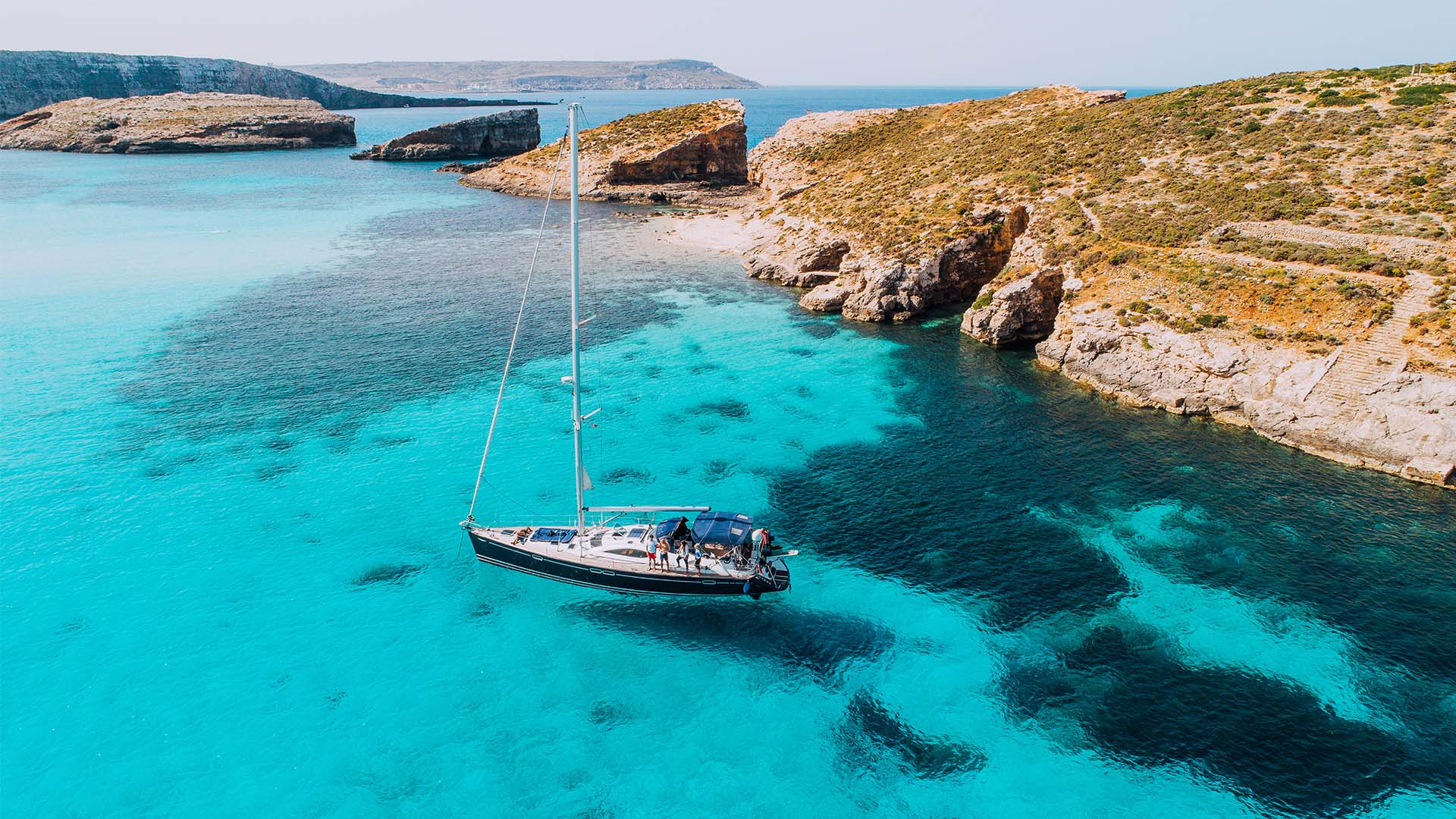 Yachting in Blue Lagoon, off the island of Comino