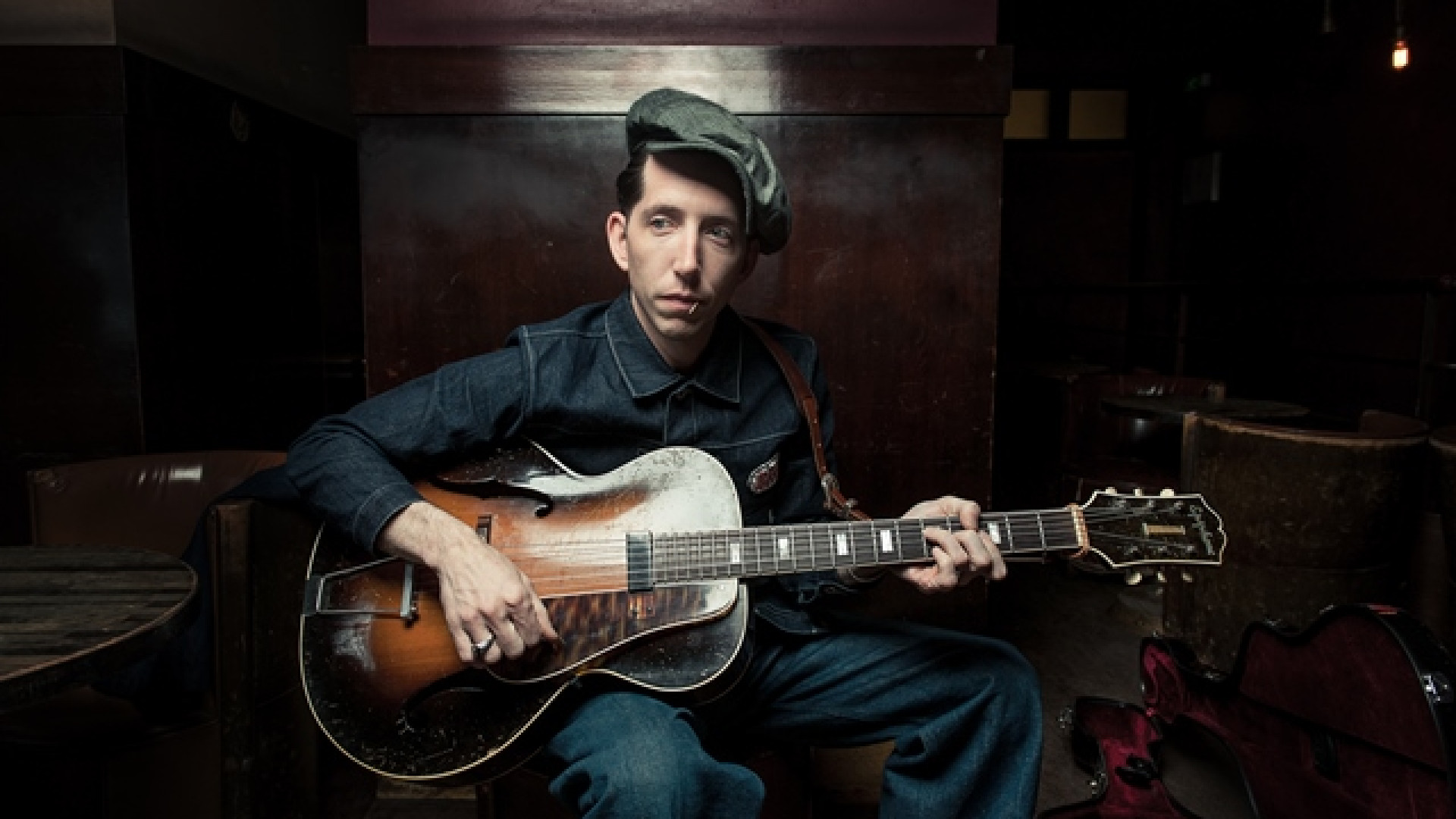 Press shot of Pokey Lafarge playing guitar