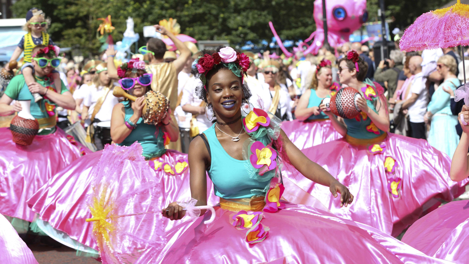 A colourful procession at Mouth of the Tyne festival