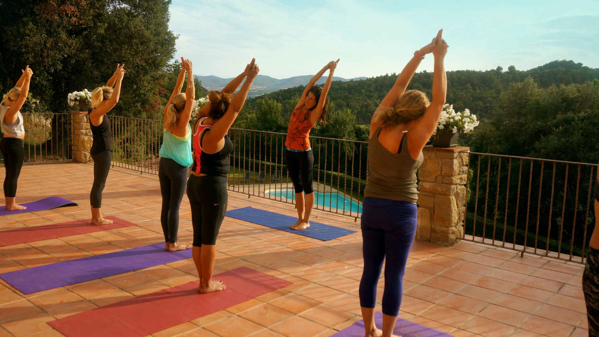A yoga class on the terrace at The Reset Button